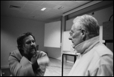 Žižek (left) converses with Badiou.